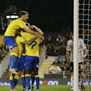 Derby players celebrate the goal of Jeff Hendrick during the English League Cup soccer match between Fulham and Derby County at Craven Cottage stadium in London, Tuesday, Oct. 28, 2014