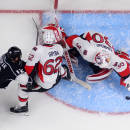 Ottawa Senators goalie Andrew Hammond, right, covers the puck as defenseman Eric Gryba, center, keeps Los Angeles Kings right wing Marian Gaborik, of Slovakia, out of the crease during the first period of an NHL hockey game, Thursday, Feb. 26, 2015, in Los Angeles. (AP Photo/Mark J. Terrill)