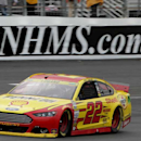 Logano holds off field, earns fourth win of 2014