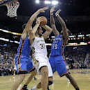 New Orleans Pelicans power forward Ryan Anderson (33) is boxed in by Oklahoma City Thunder point guard Reggie Jackson (15) and power forward Nick Collison (4) in the second half of an NBA basketball game in New Orleans, Friday, Dec. 6, 2013. The Thunder