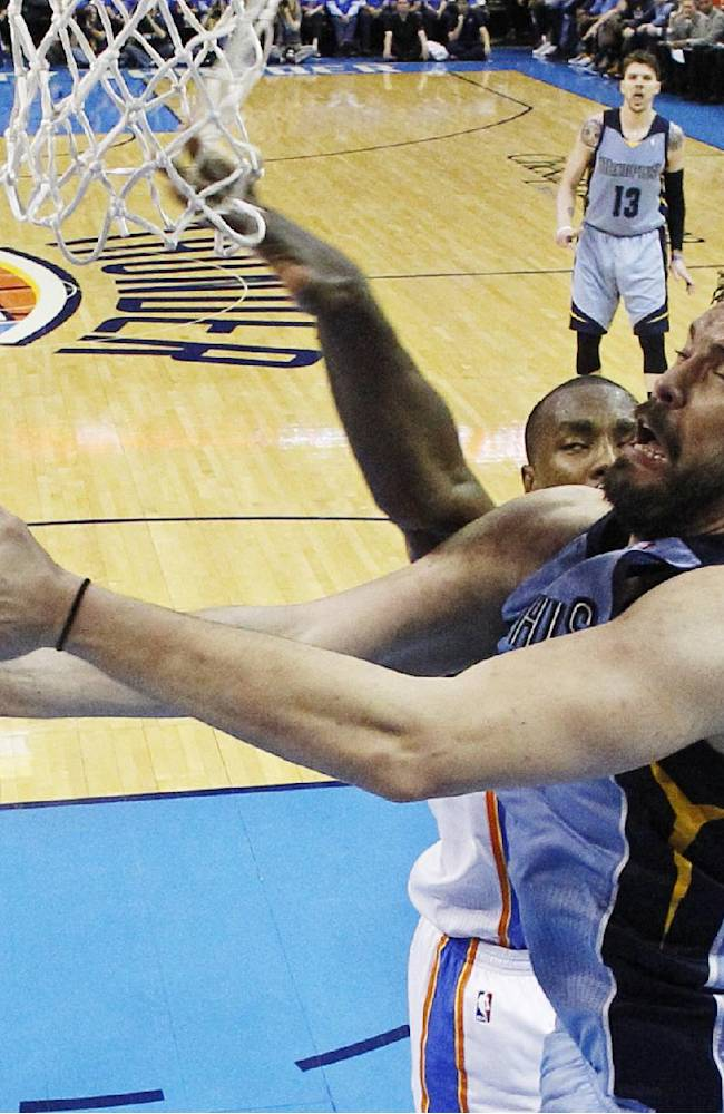 Memphis Grizzlies center Marc Gasol (33) is fouled by Oklahoma City Thunder forward Serge Ibaka (9) as he goes up for a shot in the third quarter of Game 2 of an opening-round NBA basketball playoff series in Oklahoma City, Monday, April 21, 2014. Memphis won 111-105 in overtime