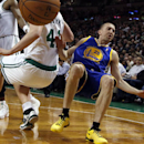 Golden State Warriors point guard Steve Blake (25) loses his balance and the ball after crashing into Boston Celtics center Kelly Olynyk (41) in the second half of an NBA basketball game in Boston, Wednesday, March 5, 2014. The Warriors won 108-88 The Ass