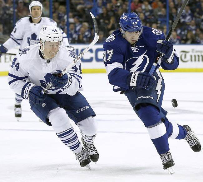 Tampa Bay Lightning center Alex Killorn (17) loses the puck as he skates around Toronto Maple Leafs defenseman Morgan Rielly (44) during the second period of an NHL hockey game, Thursday, Feb. 6, 2014, in Tampa, Fla
