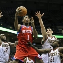 Philadelphia 76ers' Nick Young (1) drives between the Milwaukee Bucks' Luc Richard Mbah a Moute (12), Ersan Ilyasova and Samuel Dalembert during the first half of an NBA basketball game on Wednesday, Feb. 13, 2013, in Milwaukee. (AP Photo/Jim Prisching)