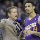 Phoenix Suns coach Jeff Hornacek, left, talks to Suns' Gerald Green (14) during a timeout in the first half of an NBA basketball game in Memphis, Tenn., Tuesday, Dec. 3, 2013. (AP Photo/Danny Johnston)
