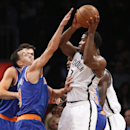 New York Knicks guard Pablo Prigioni (9) defends Brooklyn Nets shooting guard Joe Johnson (7) in the second half of their NBA basketball game at the Barclays Center, Thursday, Dec. 5, 2013, in New York The Associated Press