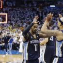 Memphis Grizzlies point guard Mike Conley (11) and Jerryd Bayless (7) celebrate at the end of Game 5 of their Western Conference Semifinals NBA basketball playoff series against the Oklahoma City Thunder in Oklahoma City, Wednesday, May 15, 2013. Memphis won 88-84. (AP Photo/Sue Ogrocki)