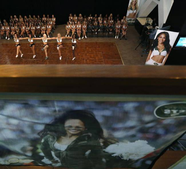 Contestants perform during the final round of the New York Jets Flight Crew cheerleading auditions at MetLife Stadium, Thursday, April 10, 2014, in East Rutherford, N.J