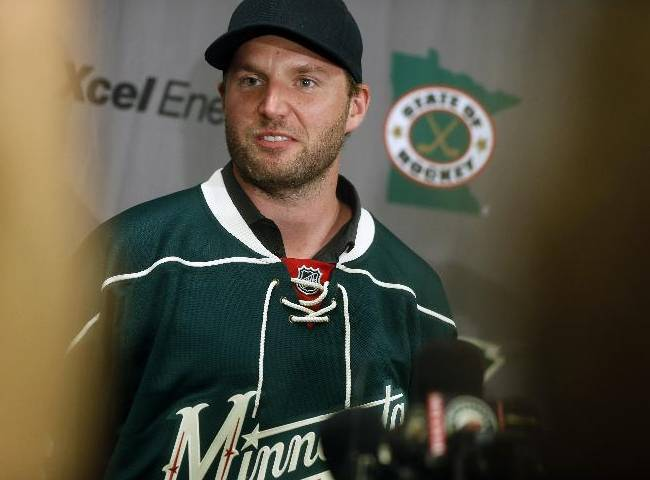 In this July 1, 2014 file photo,  Thomas Vanek poses after he signed a three-year deal to play with the Minnesota Wild NHL hockey team in St. Paul, Minn. Vanek says he's cooperating with federal authorities conducting an investigation in Rochester, N.Y. Local media report that Vanek was at the federal courthouse in Rochester Monday, July 21, 2014, to speak with officials