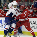 Carolina Hurricanes' Justin Faulk (27) and Washington Capitals' Alex Ovechkin (8), of Russia, struggle for possession of the puck during the first period of an NHL hockey game in Raleigh, N.C., Thursday, Dec. 4, 2014 The Associated Press