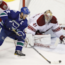 Phoenix Coyotes goaltender Mike Smith (41) makes a save against Vancouver Canucks' Henrik Sedin (22) during third period NHL hockey action in Vancouver, British Columbia, on Friday Dec. 6, 2013 The Associated Press