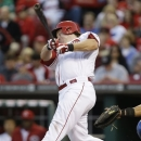 Cincinnati Reds' Ryan Hanigan hits a three-run home run off Chicago Cubs starting pitcher Scott Feldman in the fourth inning of a baseball game, Friday, May 24, 2013, in Cincinnati. (AP Photo/Al Behrman)