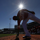 Cincinnati Reds second baseman Brandon Phillips grabs dirt on his way to the field during an exhibition baseball game against the Seattle Mariners in Goodyear, Ariz., Monday, March 3, 2014 The Associated Press
