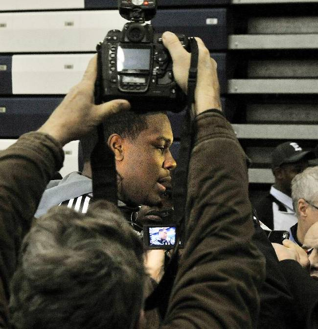 Southfield High School's Malik McDowell, center, speaks with the media after he announced that he will be attending Michigan State University to play football during a national signing day ceremony at Southfield High School's gym in Southfield, Mich., Wednesday, Feb. 5, 2014