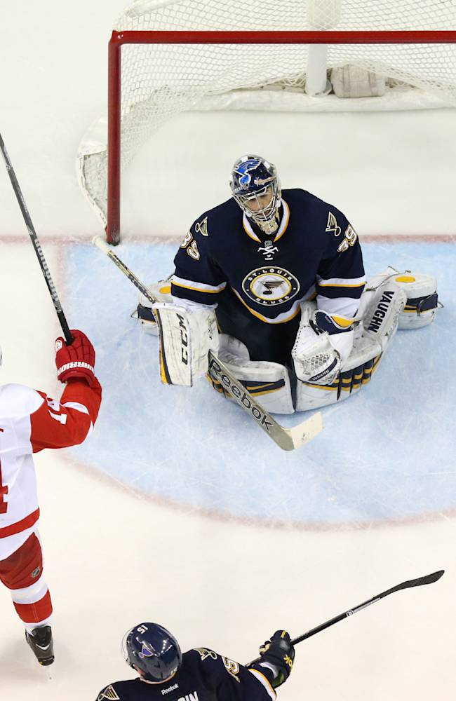 Detroit Red Wings right wing Gustav Nyquist, left, reacts after teammate Justin Abdelkader scored against St. Louis Blues goaltender Ryan Miller during the third period of an NHL hockey game Sunday, April 13, 2014, in St. Louis. Detroit won 3-0