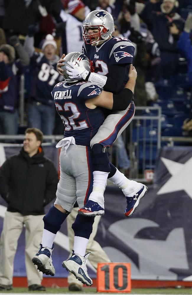 New England Patriots quarterback Tom Brady, right, celebrates his go-ahead touchdown pass with center Ryan Wendell (62) in the fourth quarter of an NFL football game against the Cleveland Browns Sunday, Dec. 8, 2013, in Foxborough, Mass. The Patriots came from behind to win 27-26