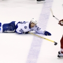 Tampa Bay Lightning's Martin St. Louis (26) slides on the ice as Phoenix Coyotes' Radim Vrbata (17), of Czech Republic, skates past in the third period of an NHL hockey game Saturday, Nov. 16, 2013, in Glendale, Ariz. The Coyotes won 6-3 The Associated Pr