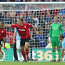 Cardiff City's Fraizer Campbell, far left, celebrates scoring his side's third goal of the game during their English Premier League match against Manchester City at Cardiff City Stadium, Cardiff, Wales, Sunday Aug. 25, 2013. (AP Photo/PA, Nick Potts)