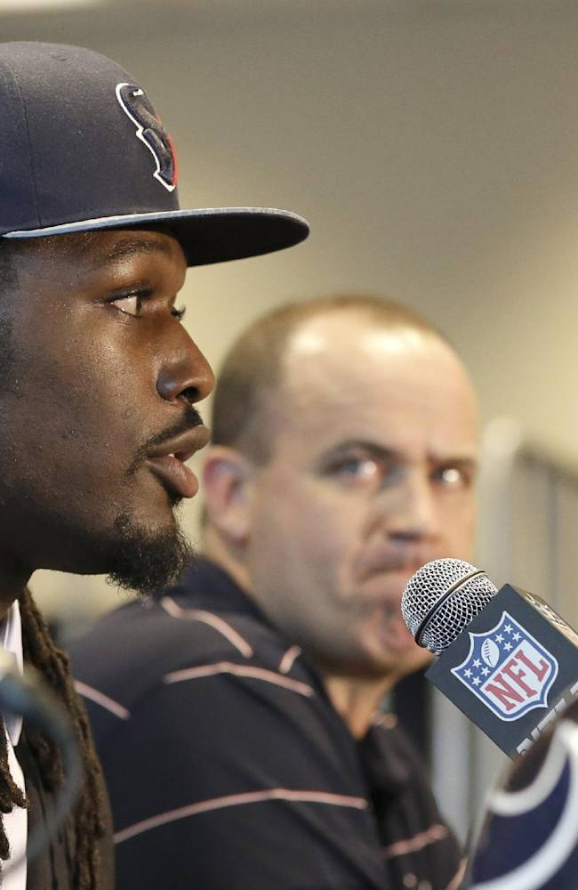 In this May 9, 2014, file photo, Houston Texans No. 1 overall NFL draft pick Jadeveon Clowney speaks during an introductory NFL football news conference as coach Bill O'Brien, right, looks on, in Houston. Clowney says he'll start Saturday's, Aug. 9, 2014,  preseason opener in Arizona after sitting out the last three practices. But Texans coach Bill O'Brien seemed surprised by Clowney's proclamation