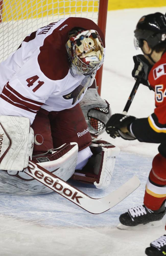 Flames beat Coyotes 3-2 to end 7-game home skid