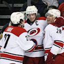 Carolina Hurricanes' Justin Faulk (27), and Alexander Semin (28), celebrate a goal by Eric Staal, center, during the second period of an NHL hockey game against the Buffalo Sabres in Buffalo, N.Y., Tuesday, Feb. 25, 2014 The Associated Press
