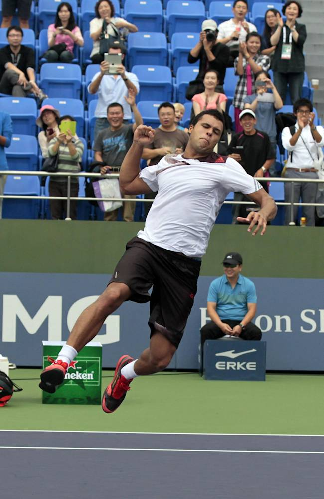 Jo-Wilfried Tsonga of France jumps in celebration after defeating Pablo Andujar of Spain in their singles match at the Shanghai Masters tennis tournament at Qizhong Forest Sports City Tennis Center, in Shanghai, China, Wednesday, Oct. 9, 2013