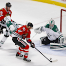 Chicago Blackhawks right wing Marian Hossa (81) attempts to score against Dallas Stars goalie Kari Lehtonen (32) during the second period of an NHL hockey game, Sunday, Jan. 18, 2015, in Chicago The Associated Press