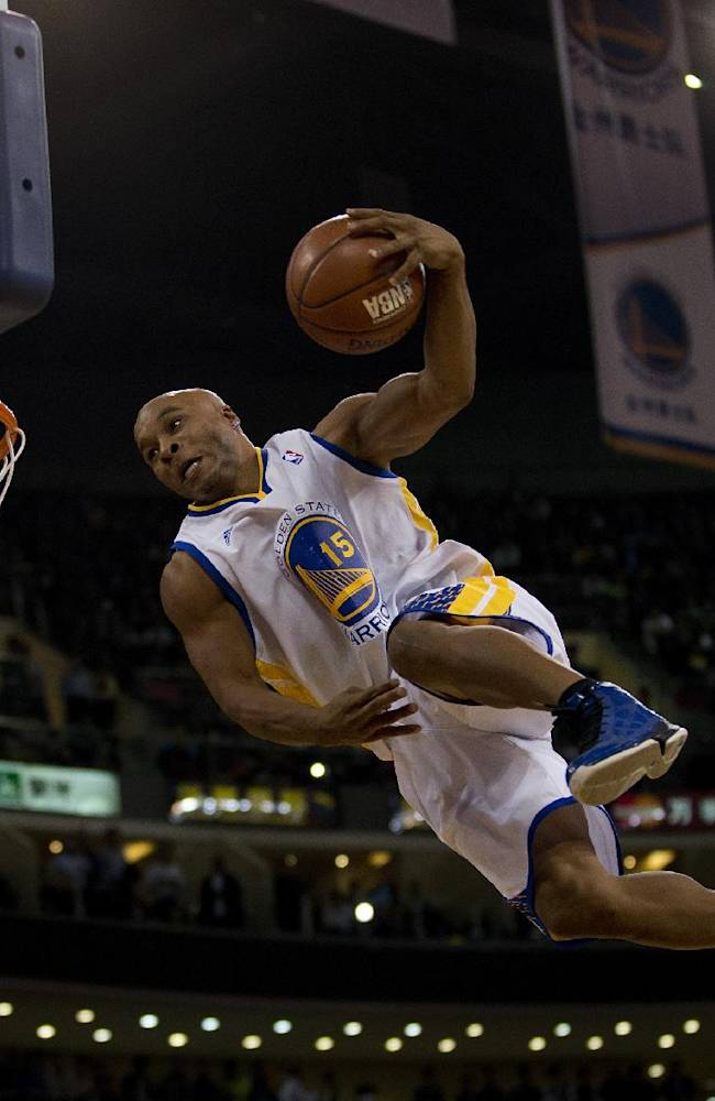 A member of the Flying Dubs, an acrobatic dunk team of the Golden State, Warriors performs during the NBA Global Games match between Golden State Warriors and LA Lakers at the Wukesong Stadium in Beijing, Tuesday, Oct. 15, 2013