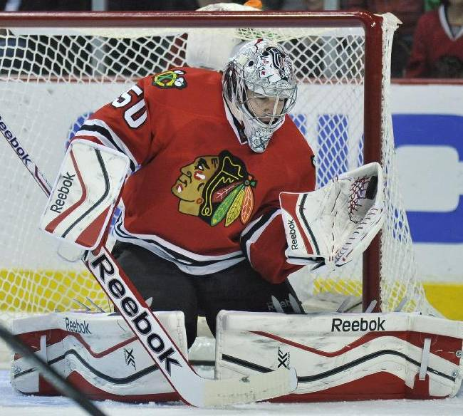 Chicago Blackhawks goalie Corey Crawford makes a save during the first period of an NHL hockey game against the St. Louis Blues in Chicago, Wednesday, March, 19, 2014