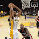 Los Angeles Lakers forward Xavier Henry, left, goes up for a dunk as Portland Trail Blazers guard Mo Williams defends during the second half of an NBA basketball game, Sunday, Dec. 1, 2013, in Los Angeles The Associated Press