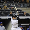 New York Yankees' John Ryan Murphy hits a single during the fourth inning of Game 2 of an interleague baseball doubleheader against the Chicago Cubs, Wednesday, April 16, 2014, at Yankee Stadium in New York The Associated Press