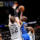 Carl Landry #7 of the Golden State Warriors shoots in the lane against Tiago Splitter #22 of the San Antonio Spurs in Game Two of the Western Conference Semifinals during the 2013 NBA Playoffs on May 8, 2013 at the AT&T Center in San Antonio, Texas