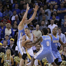 Golden State Warriors' Stephen Curry is guarded by Denver Nuggets' Aaron Brooks (0), Randy Foye (4) and Timofey Mozgov during the second half of an NBA basketball game Thursday, April 10, 2014, in Oakland, Calif The Associated Press