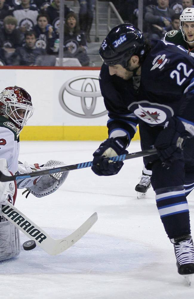 Wheeler lifts Jets to 6-4 win over Wild