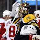 Boston Bruins goalie Tuukka Rask grimaces as Detroit Red Wings celebrate Pavel Datsyuk's goal during the third period of Detroit's 1-0 win in Game 1 of a first-round NHL playoff hockey game in Boston on Friday, April 18, 2014 The Associated Press