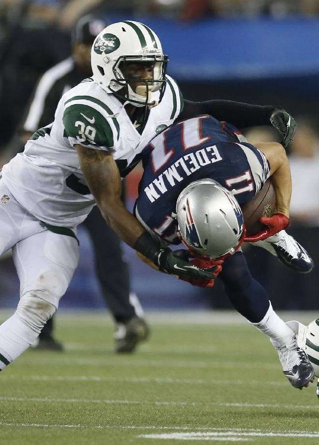 New York Jets free safety Antonio Allen (39) and cornerback Kyle Wilson, right, tackle New England Patriots wide receiver Julian Edelman (11) in the first quarter of an NFL football game Thursday, Sept. 12, 2013, in Foxborough, Mass