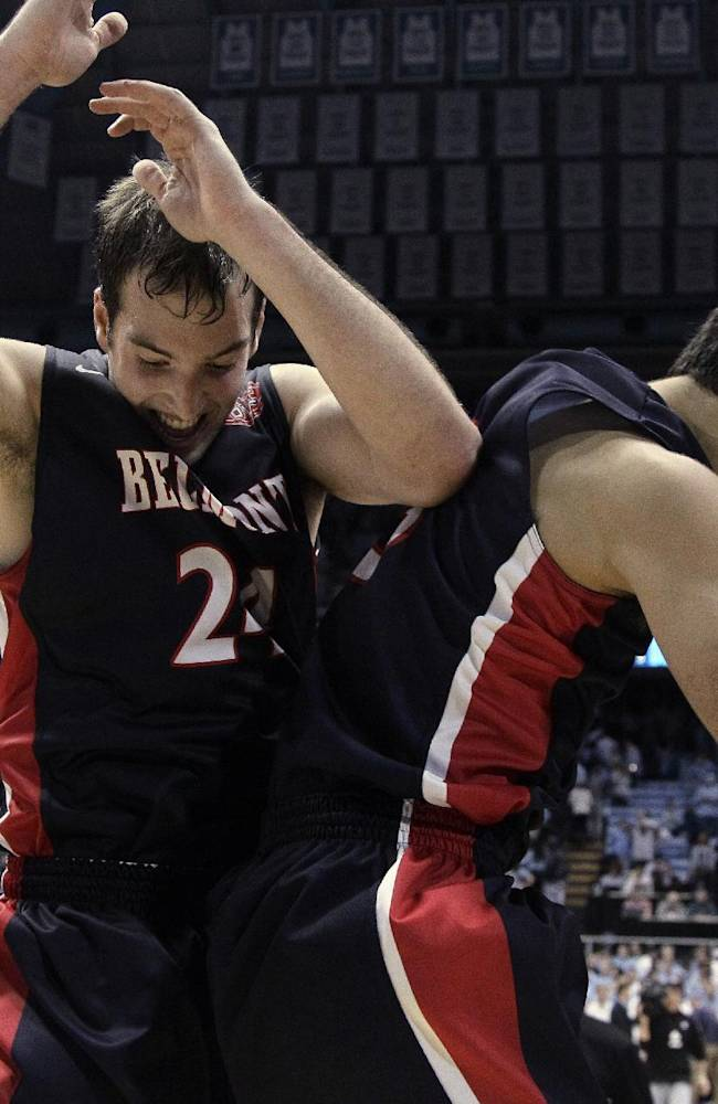 Belmont's J.J. Mann (24) and Caleb Chowbay, right, celebrate following Belmont's 83-80 win over North Carolina in an NCAA college basketball game in Chapel Hill, N.C., Sunday, Nov. 17, 2013