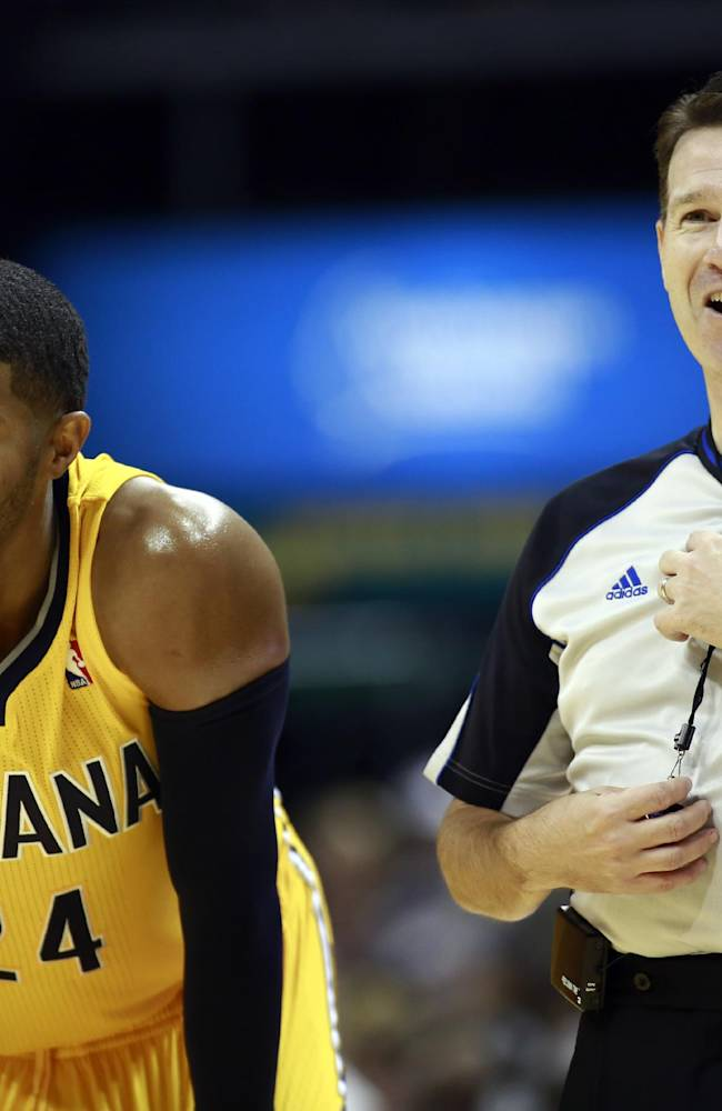 Indiana Pacers forward Paul George (24) laughs with an official in the second half of an NBA basketball game against the Orlando Magic in Indianapolis, Tuesday, Oct. 29, 2013. The Pacers won 97-87