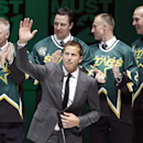 Former Dallas Stars player Mike Modano waves to the crowd during a jersey retirement ceremony before the Stars played the Minnesota wild in an NHL hockey game in Dallas on Saturday, March 8, 2014 The Associated Press