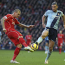 Liverpool's Martin Skrtel, left, and West Ham United's Andy Carroll battle for the ball during their English Premier League soccer match at Anfield, Liverpool, England, Saturday, Jan. 31, 2015