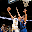 OAKLAND, CA - OCTOBER 21: Stephen Curry #30 of the Golden State Warriors shoots a layup against Spencer Hawes #10 of the Los Angeles Clippers on October 21, 2014 at Oracle Arena in Oakland, California. (Photo by Noah Graham/NBAE via Getty Images)
