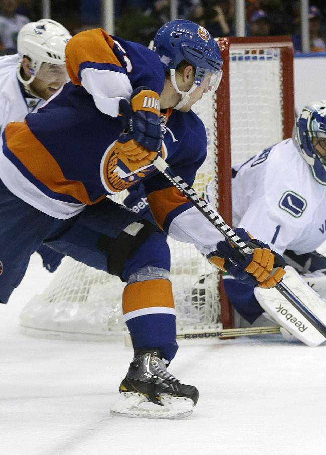 Vancouver Canucks goalie Roberto Luongo (1) stops a shot on the goal by New York Islanders' Casey Cizikas (53) during the second period of an NHL hockey game Tuesday, Oct. 22, 2013 in Uniondale, N.Y