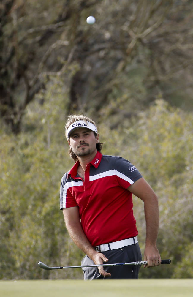Oosthuizen tries to cope with a back injury