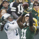 Green Bay Packers' Tramon Williams breaks up a pass intended for Carolina Panthers' Kelvin Benjamin during the second half of an NFL football game Sunday, Oct. 19, 2014, in Green Bay, Wis. (AP Photo/Morry Gash)