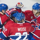 Montreal Canadiens' P.K. Subban, second left, celebrates with teammates Sergei Gonchar (55) Dale Weise (22) and Manny Malhotra (20) after scoring against the Los Angeles Kings during the second period of an NHL hockey game, Friday, Dec. 12, 2014 in Montre
