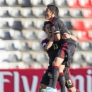 Mexico's Jorge Espericueta, top, celebrates scoring the opening goal with teammate Jose Abella during the Under-20 World Cup Group D soccer match between Mexico and Greece in Gaziantep, Turkey, Saturday, June 22, 2013. (AP Photo/Gero Breloer)