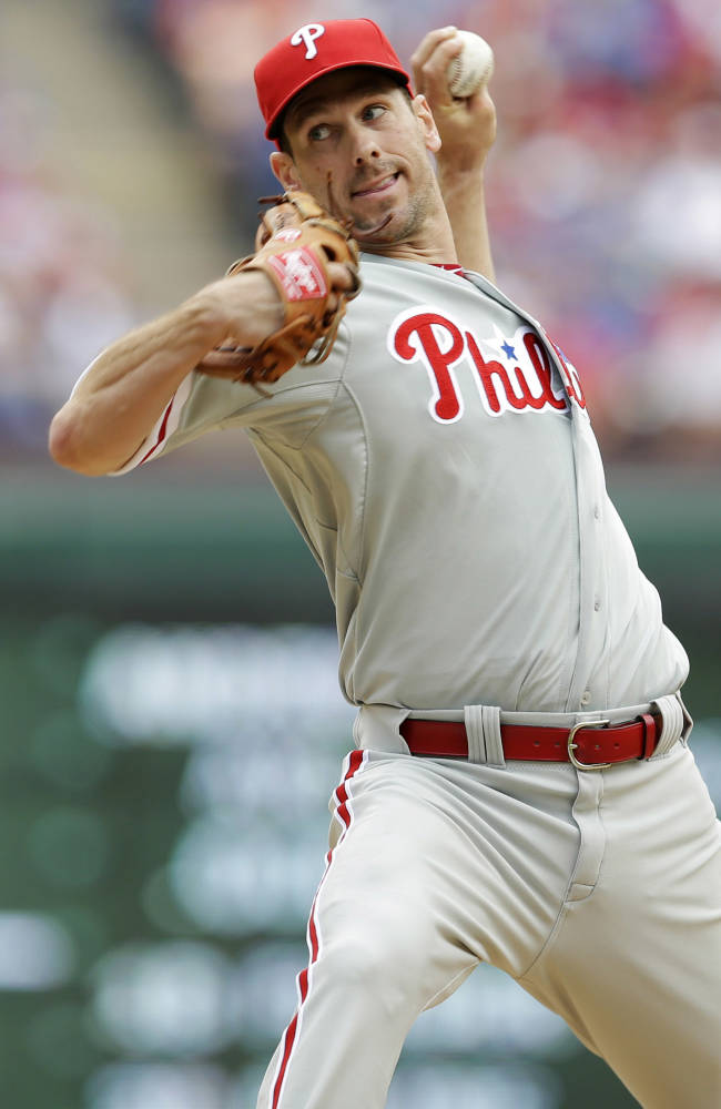 Philadelphia Phillies starting pitcher Cliff Lee delivers the ball to the Texas Rangers during the fourth inning of an opening day baseball game at Globe Life Park, Monday, March 31, 2014, in Arlington, Texas