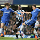 Chelsea's David Luiz, left and teammate Nemanja Matic take the ball from Newcastle's Sammy Ameobi, center, during their English Premier League soccer match between Chelsea and Newcastle United in London, Saturday, Feb. 8, 2014