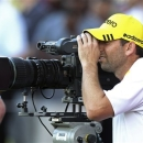 Spain's Sergio Garcia looks through a television camera viewfinder during the Third round of the Commercial Bank Qatar Masters held at the Doha Golf Club in Qatar, Thursday, Jan. 24, 2013. (AP Photo/Osama Faisal)