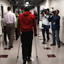 Chicago Bulls' Derrick Rose walks down a hall on crutches after an NBA basketball news conference about his injured knee at the United Center Thursday, Dec. 5, 2013, in Chicago The Associated Press